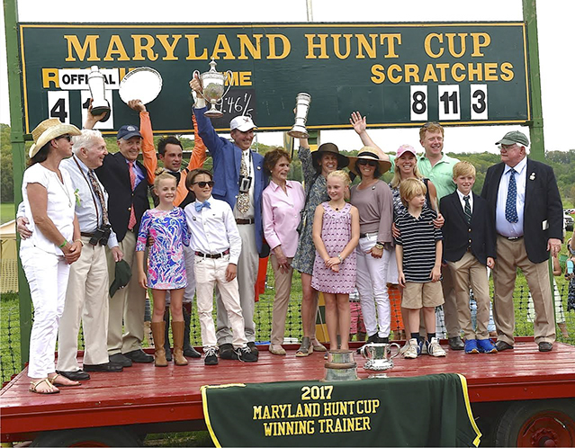 The winning connections for the 2017 Maryland Hunt Cup gather on the wagon for the trophy presentation